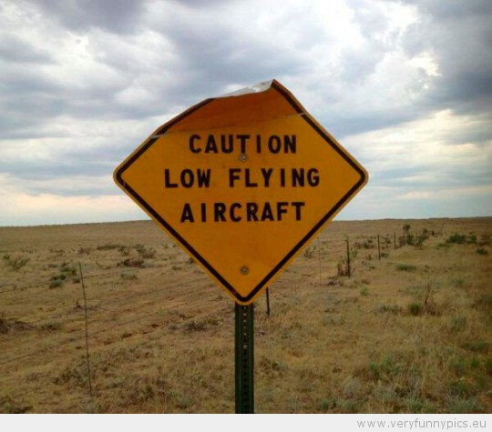 Funny Picture - Sign saying caution low flying aircraft