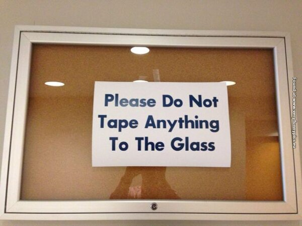 funny pictures tape sign