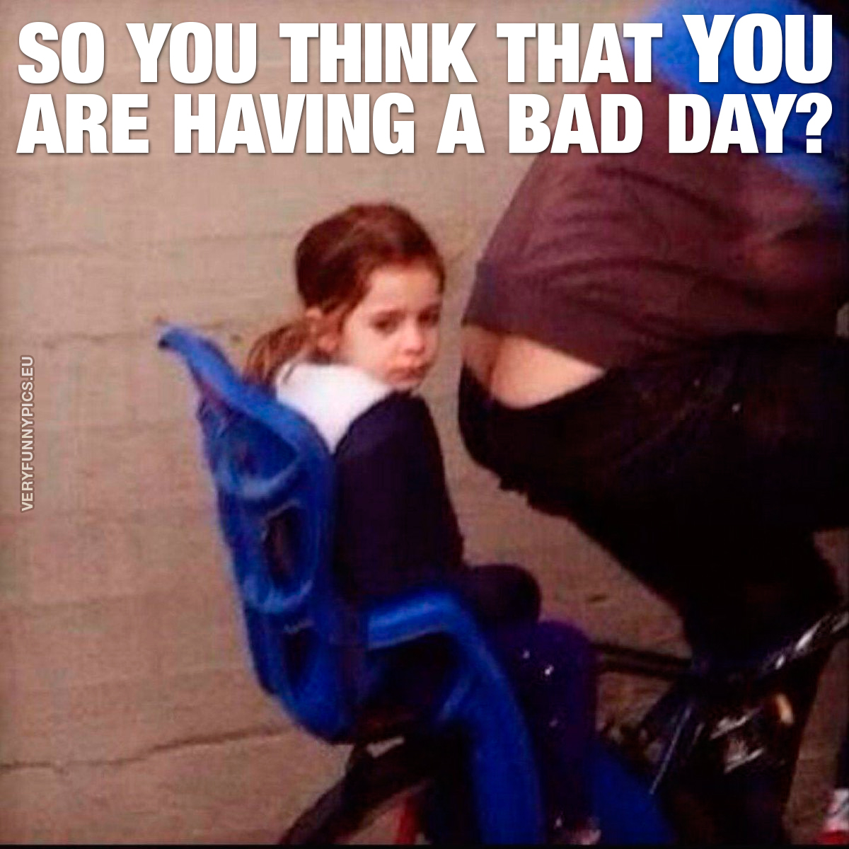 A girl is getting a ride on a bicycle